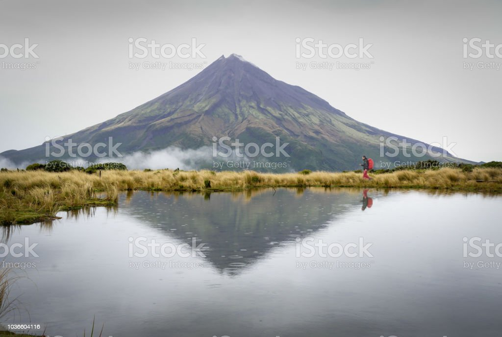 Hiking in Mount Taranaki in the rain, Egmont National Park stock photo