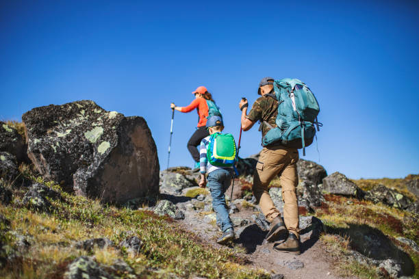 Hiking in mountains alone stock photo