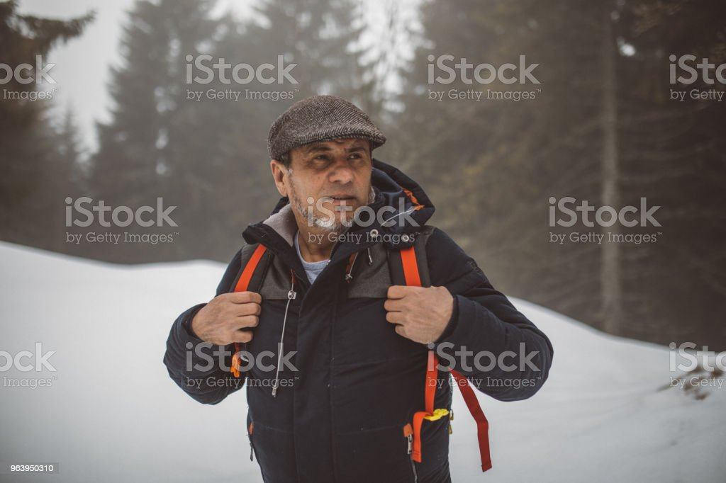 Hiking in snow - Royalty-free Active Seniors Stock Photo
