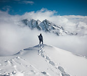 Mountain climbing in pure winter conditions.