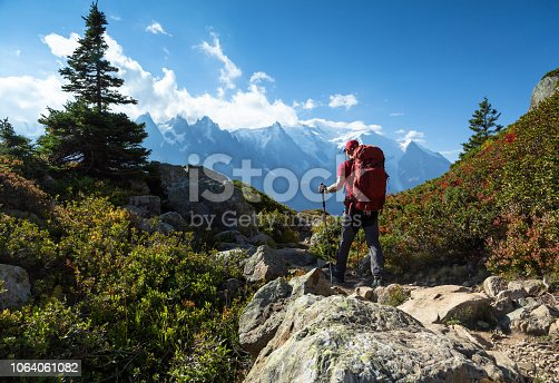 A man hiking on the famous Tour du Mont Blanc near Chamonix, France.