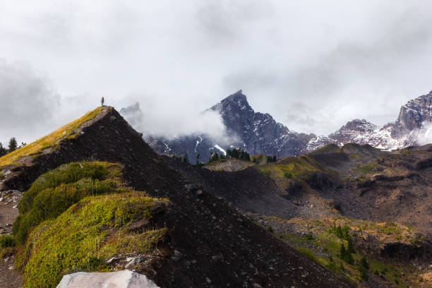 Hiking in the Mountains Surrounded by Clouds stock photo