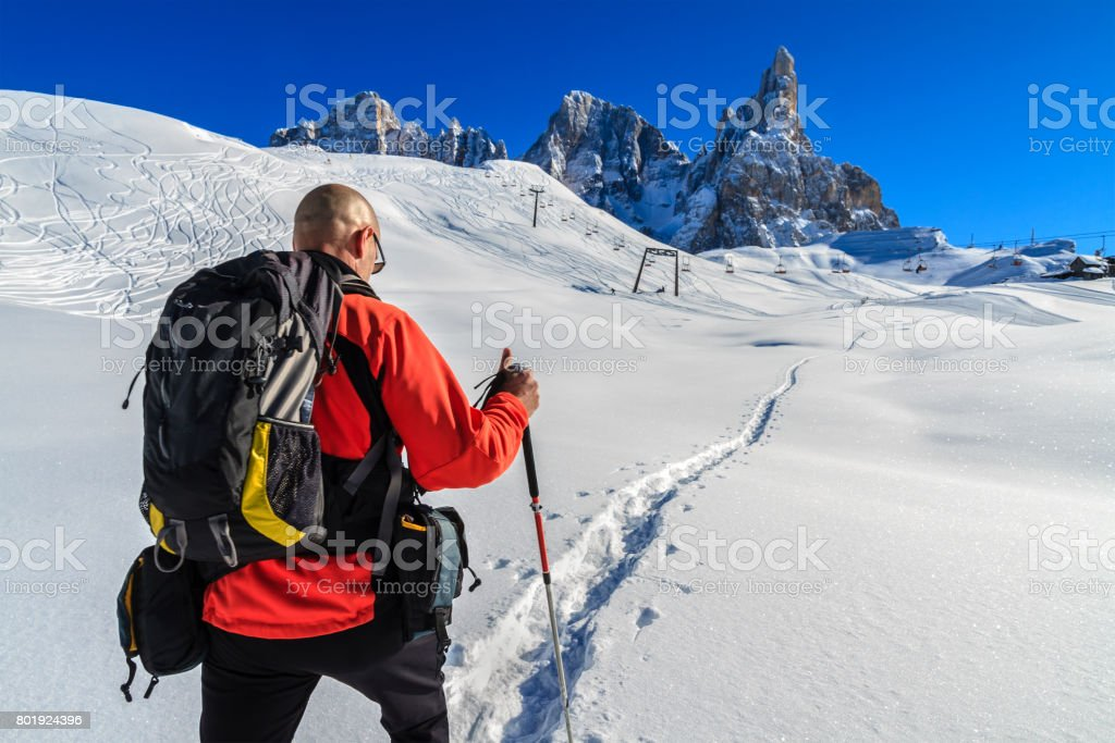Hiking in the Pale di San Martino Natural Park in winter, Italy stock photo