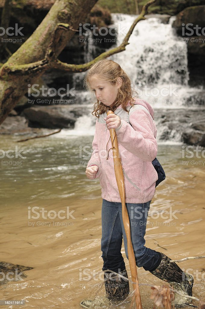 Hiking in water by waterfall royalty-free stock photo