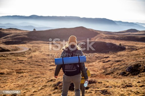 Portrait of a woman hiking in the beautiful mountain landscape.