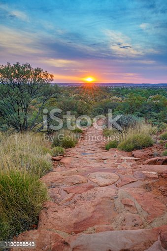 hiking kings canyon at romantic sunset, watarrka national park, northern territory, australia
