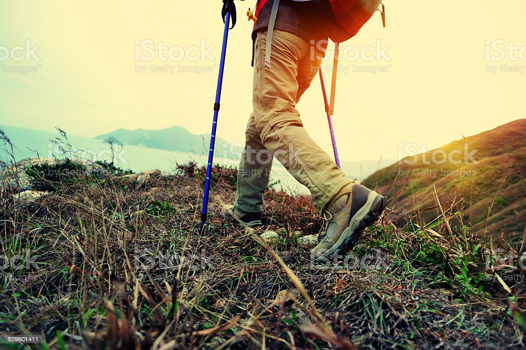 hiking legs seaside mountain peak stock photo