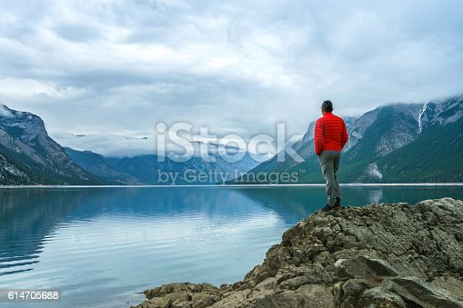 Hiking man arms open to nature view