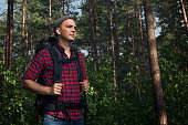 istock Hiking man in the forest 1049025856
