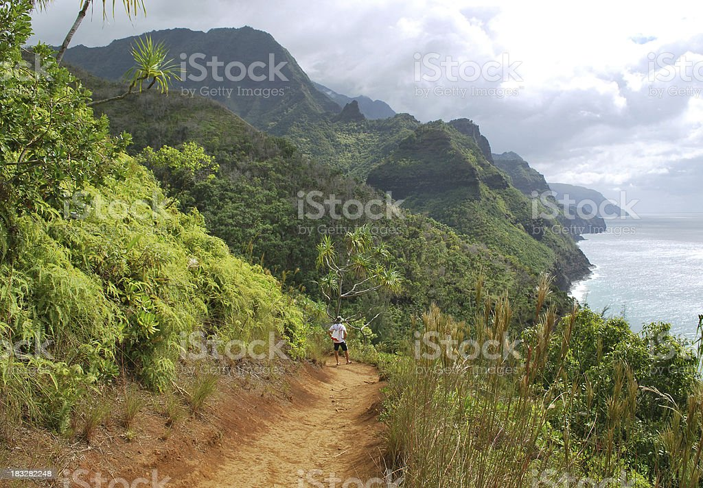 Hiking Na Pali Coast in Kauai, Hawaii. stock photo