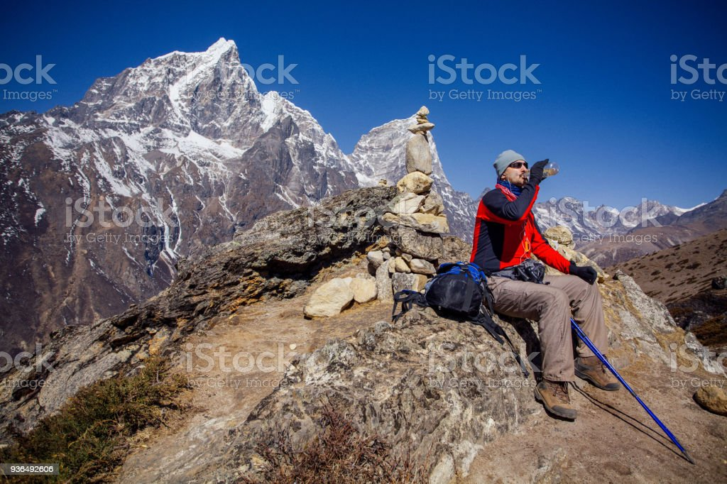 Hiking on Himalayas on Everest trek stock photo