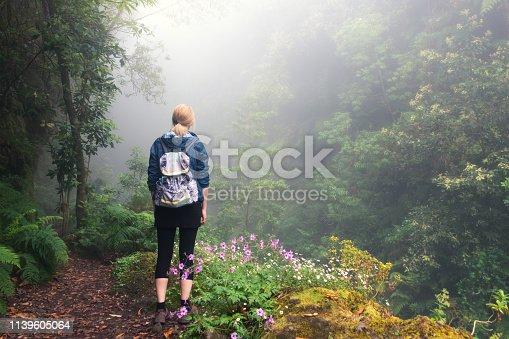 Woman enjoying the beautiful outdoors in Madeira island.