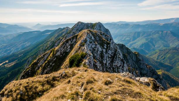 Hiking on Piatra Craiului mountain ridge stock photo