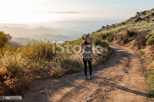 Woman on a leisurely hike in San Diego