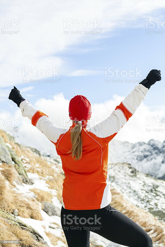 Hiking success, woman in winter mountains royalty-free stock photo