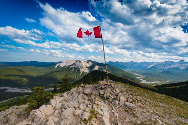 Hiking Sunrise Hill Canadian Flag on top of Sunrise Hill and in Kananaskis Country Alberta Canada kananaskis country stock pictures, royalty-free photos & images