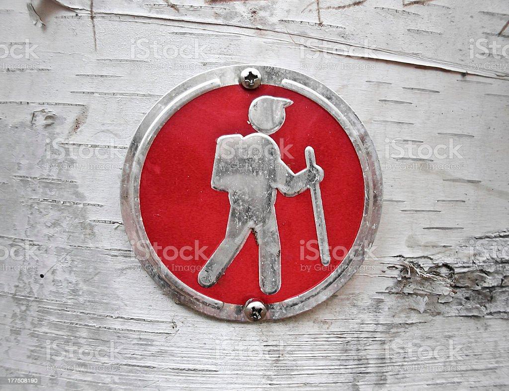 Hiking Symbol on Tree stock photo