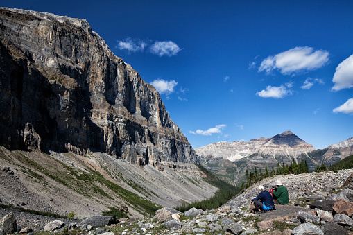 Couple hiking the Stanley Glacier in Kootney National Park, BC, Canada
