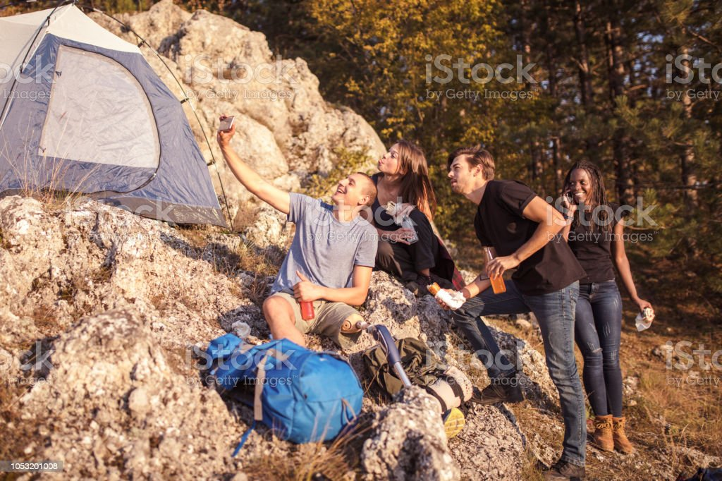 Friends have a fun while camping. Inclusive recreation.