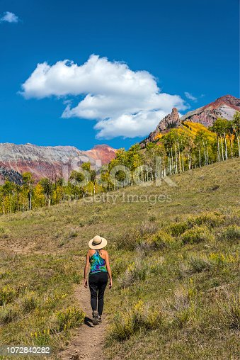 Woman hiking in the Iron Mountain area of the Sneffels Range near Telluride, Colorado.