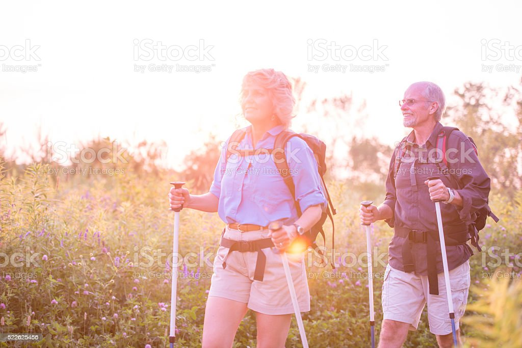 Hiking Together at Dusk stock photo