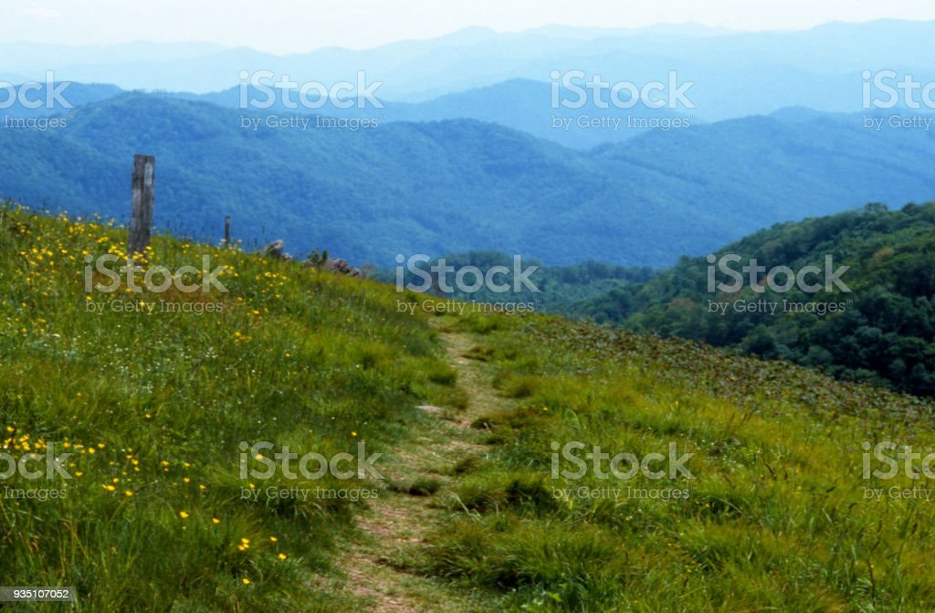 A hiking trail across a mountain peak in spring. stock photo