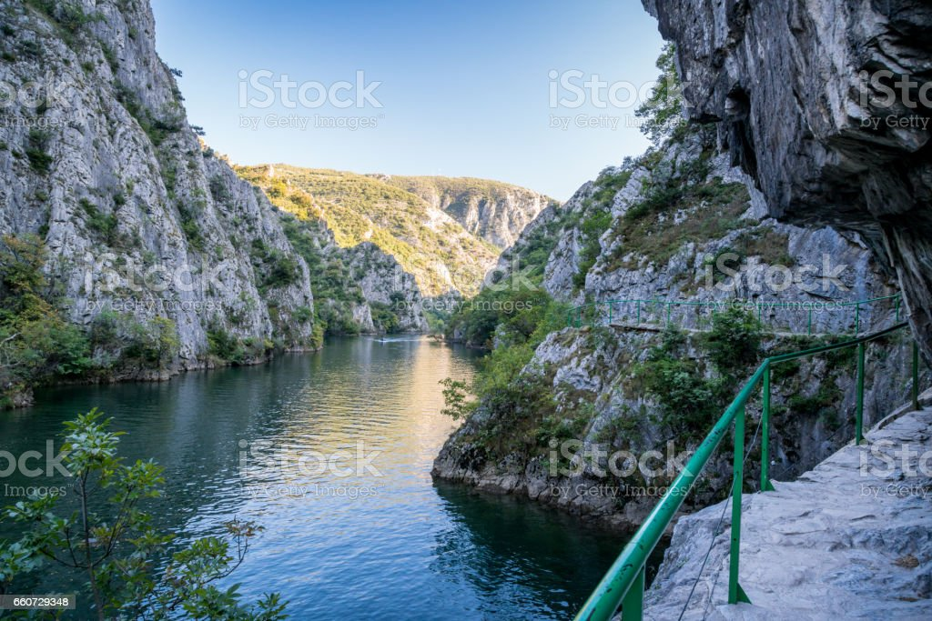 Hiking trail along side a mountain. View of beautiful tourist attraction, lake at Matka Canyon in the Skopje surroundings, Macedonia. royalty-free stock photo