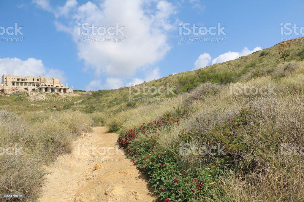 Hiking trail around Ghajn Tuffieha Bay at the Mediterranean Sea in Malta stock photo