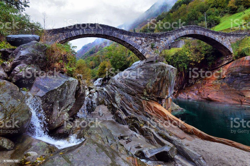 hiking Trail at the famous Roman Bridge called Ponte dei Salti in Lavertezzo,Verzasca Valley,Ticino Canton,Switzerland stock photo