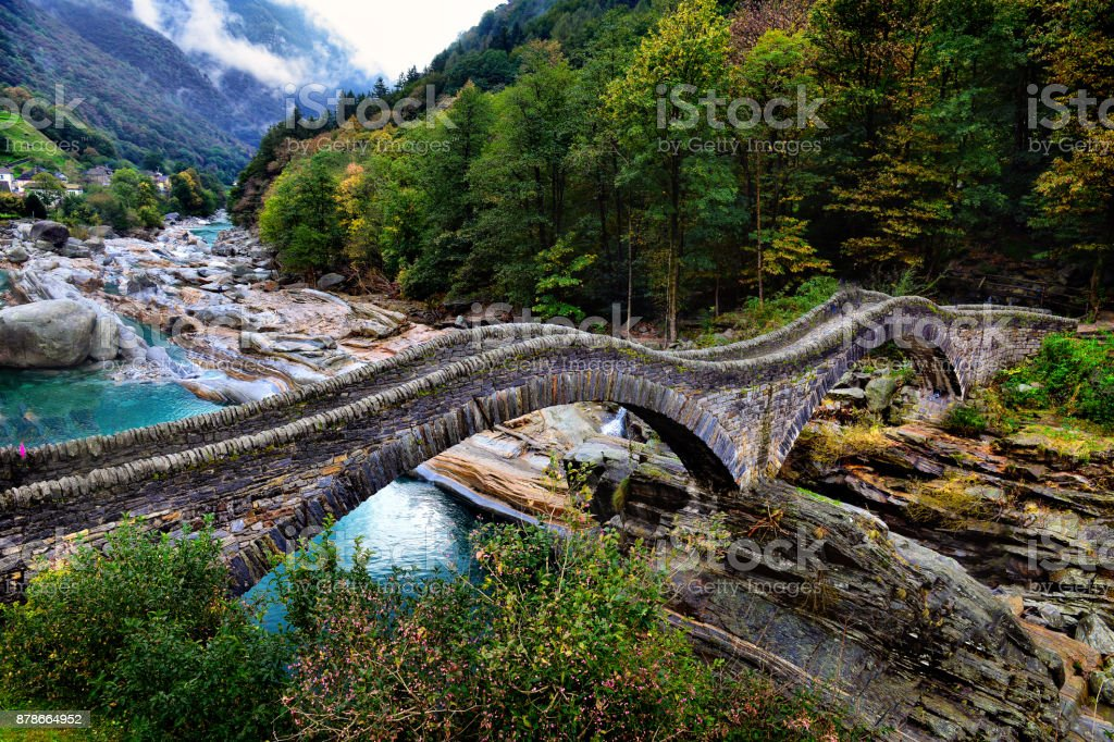 hiking Trail at the famous Roman Bridge called Ponte dei Salti in Lavertezzo,Verzasca Valley,Ticino Canton,Switzerland stock photo