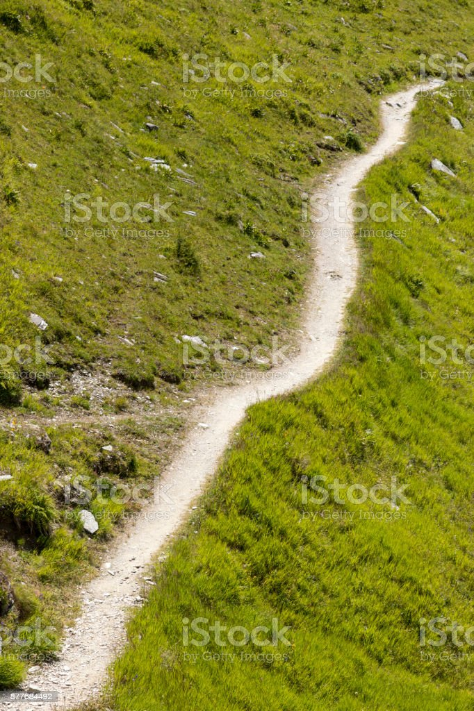 Hiking trail in the swiss alps, Grisons, Switzerland stock photo