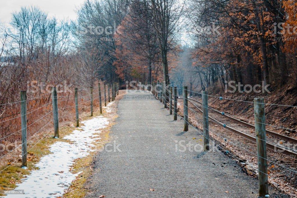 Hiking trail running alongside the railroad tracks zbiór zdjęć royalty-free