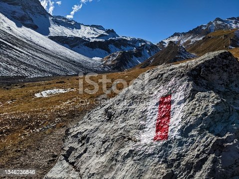 istock hiking trail sign in the grisons mountains. Swiss hiking trail, red and white. Mountain hiking trail. Autumn time 1346236846