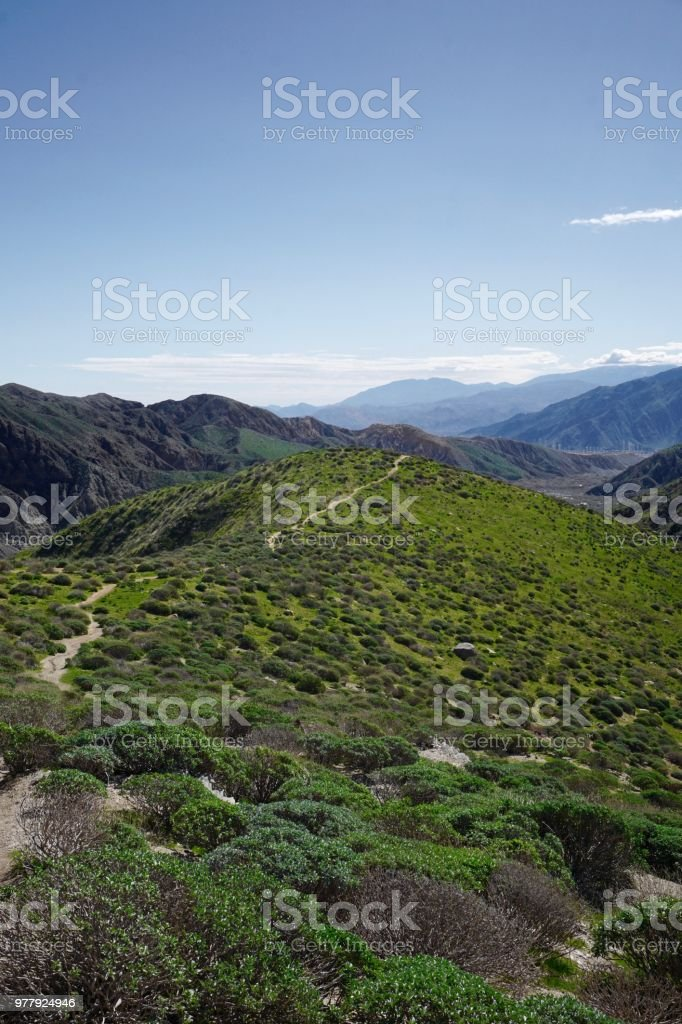Hiking trail through rolling hills in Whitewater, California stock photo