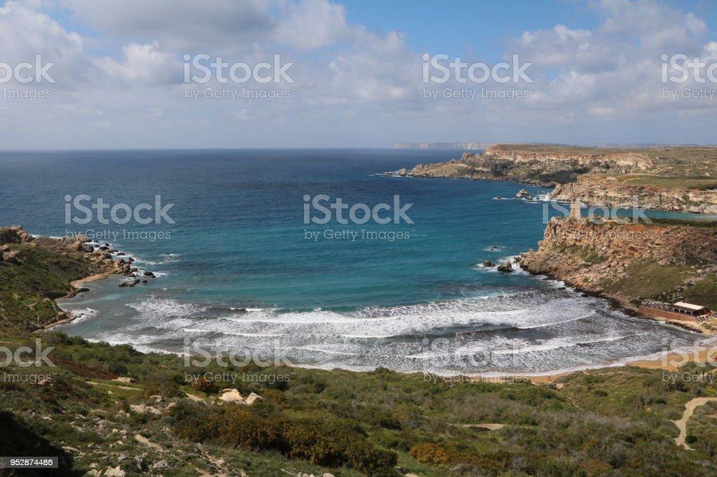Hiking trail to Gnejna Bay at the Mediterranean Sea in Malta stock photo