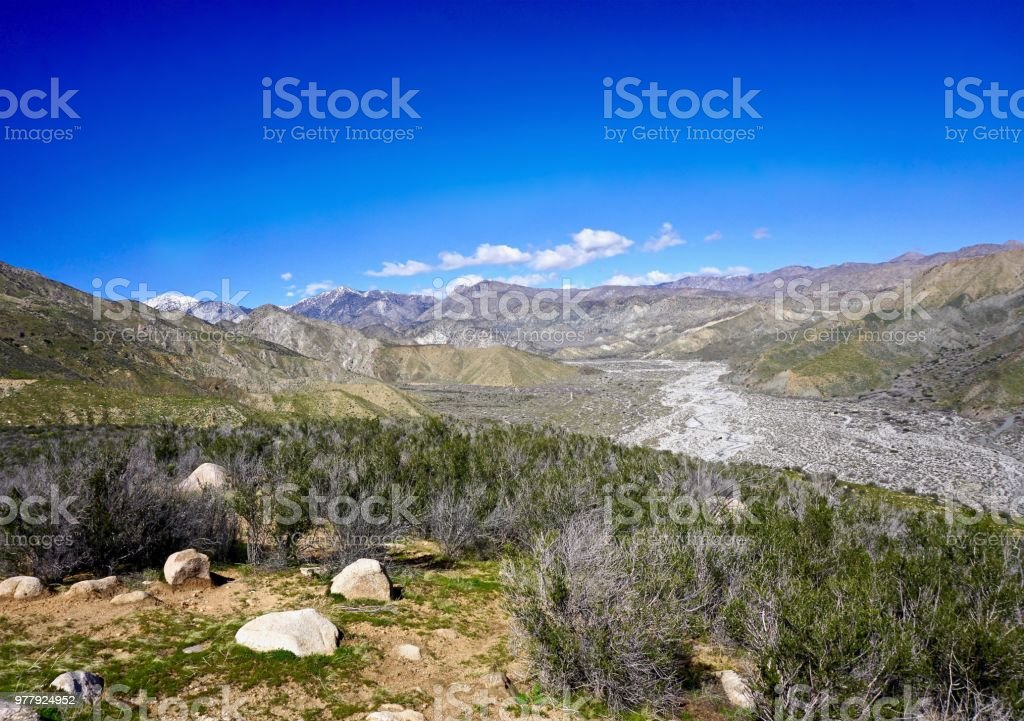 hiking trails along dry river basin stock photo