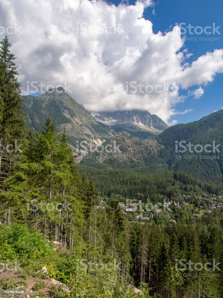 Hiking, trekking train path near Chamonix Mont BLanc, Haute Savoie, France in summer. View to the Alps from the petit balcon sud - the small south trail. stock photo