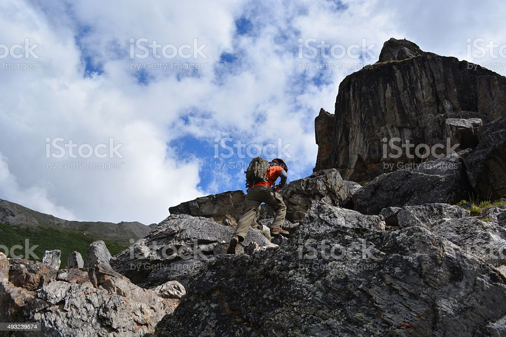 Hiking up a Rocky Mountain stock photo