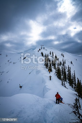 istock Hiking up a Snowcovered Peak to Ski 1219429791