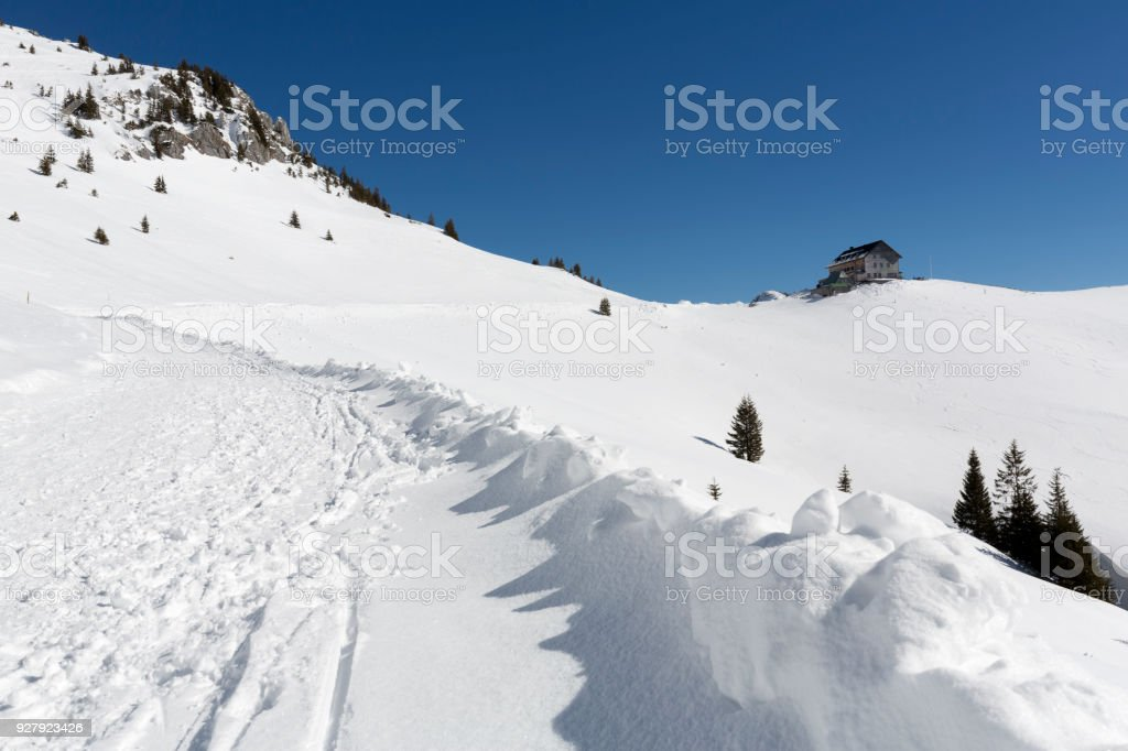 Hiking up to the Rotwandhaus shelter in the bavarian alps in winter stock photo