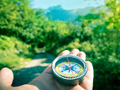hiking with compass in mountains