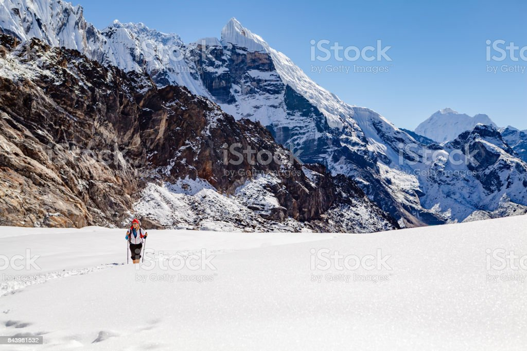 Hiking Woman Crossing Cho La Pass in Himalaya Mountain s, Nepal stock photo