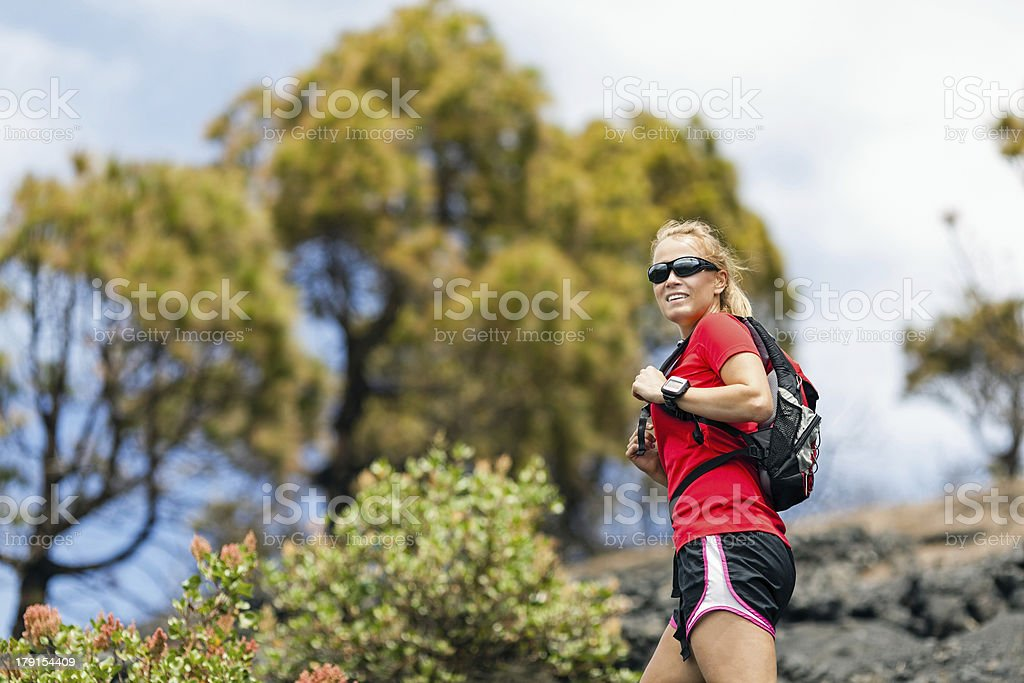 Hiking woman, runner in summer mountains royalty-free stock photo