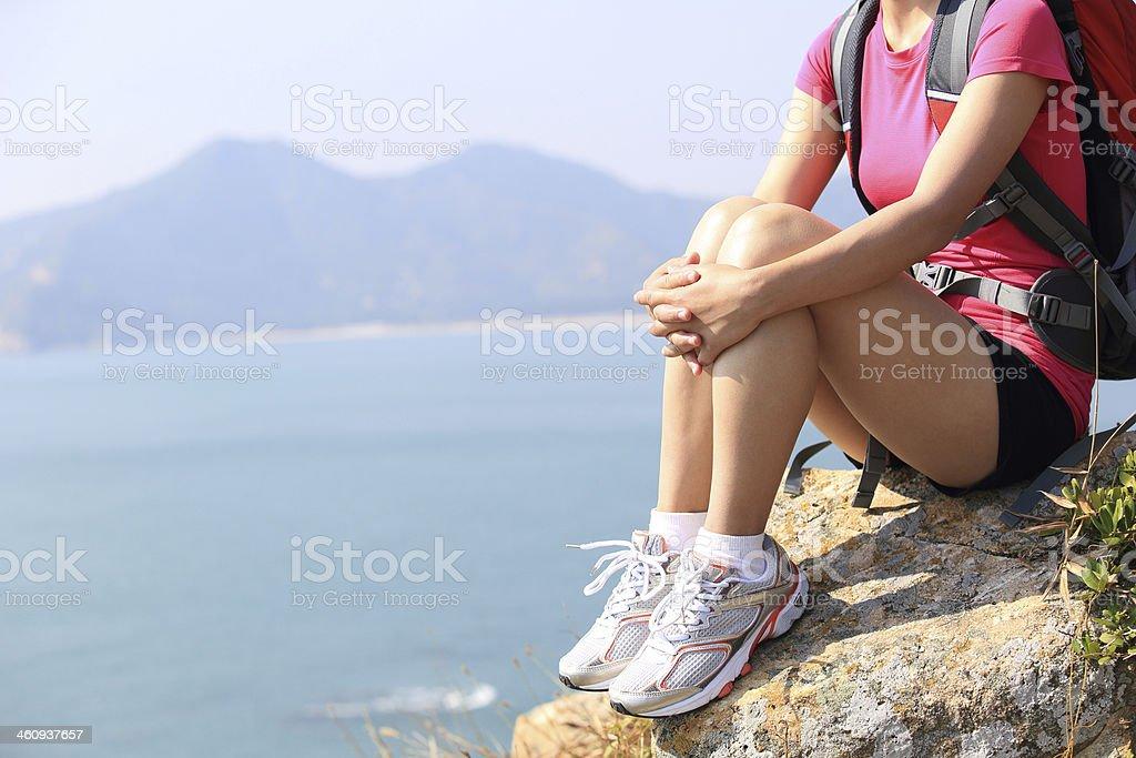 hiking woman sit on rock stock photo