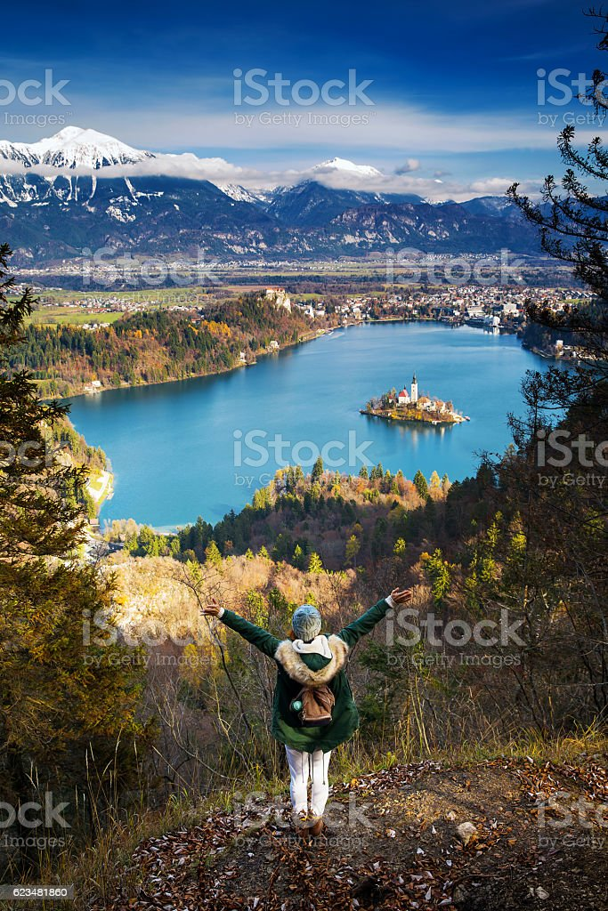 Hiking woman with alps mountains and alpine lake on background stock photo