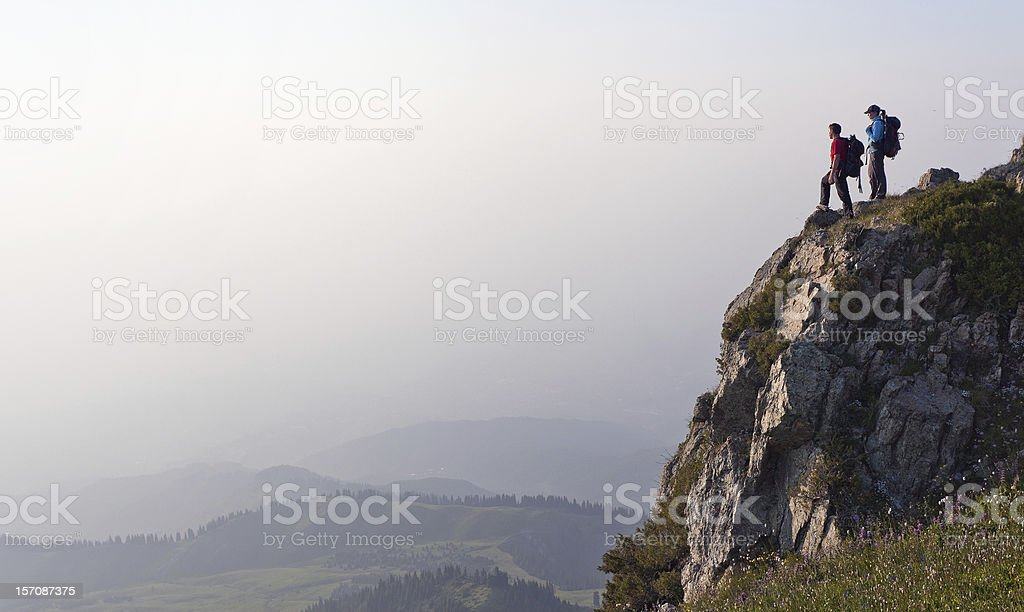 hiking young couple at the top royalty-free stock photo