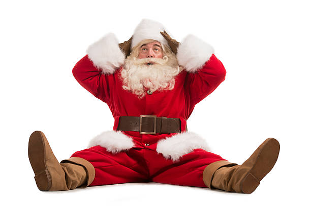 Hilarious and funny Santa Claus confused while sitting stock photo