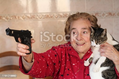 Hilarious lady protecting her cat.