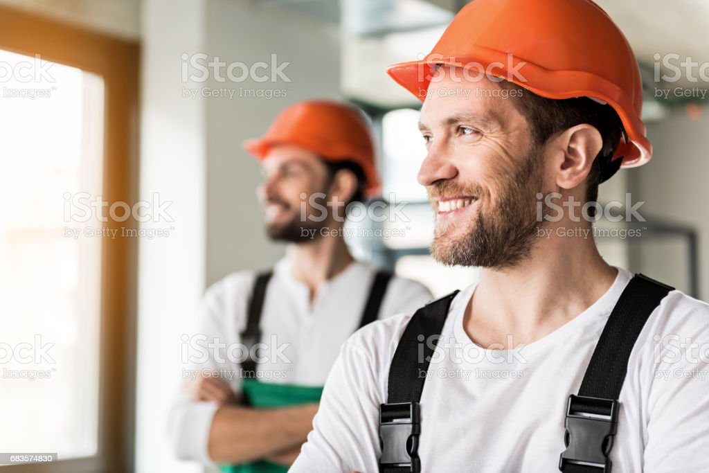 Hilarious smiling erectors in room stock photo