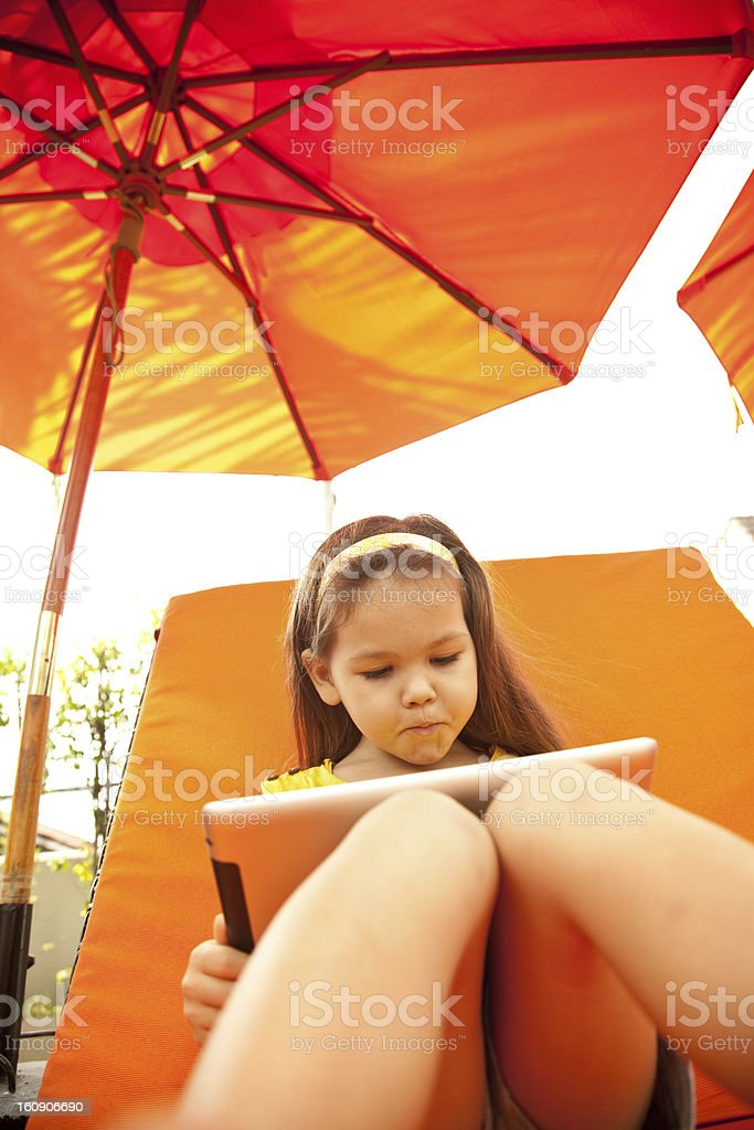 Сhild with tablet royalty-free stock photo